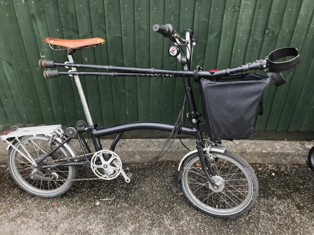 Crutches mounted on Brompton